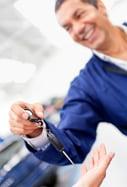 Mechanic handling keys of a car at the garage-1